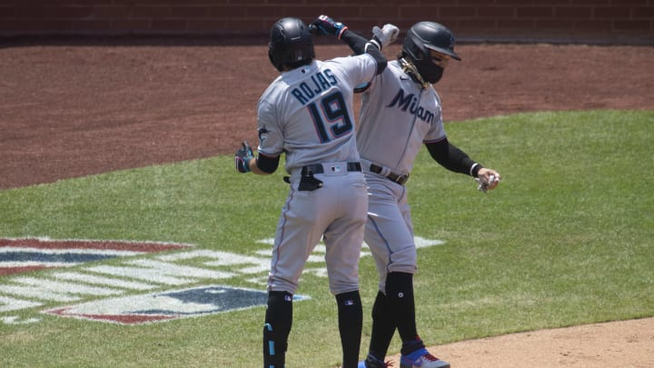 Members of the Miami Marlins celebrate during one of their three games this season.