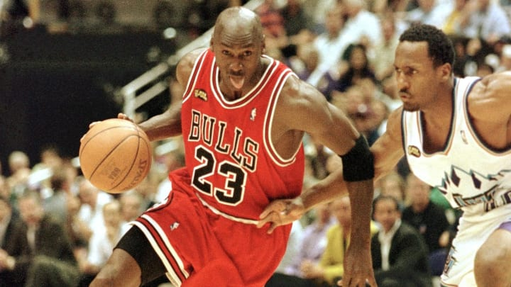 SALT LAKE CITY, UNITED STATES:  Michael Jordan (L) of the Chicago Bulls goes to the basket past Shandon Anderson of the Utah Jazz 14 June during game six of the NBA Finals at the Delta Center in Salt Lake City, UT. The Bulls lead the best-of-seven series 3-2.        AFP PHOTO/Mike NELSON (Photo credit should read MIKE NELSON/AFP/Getty Images)