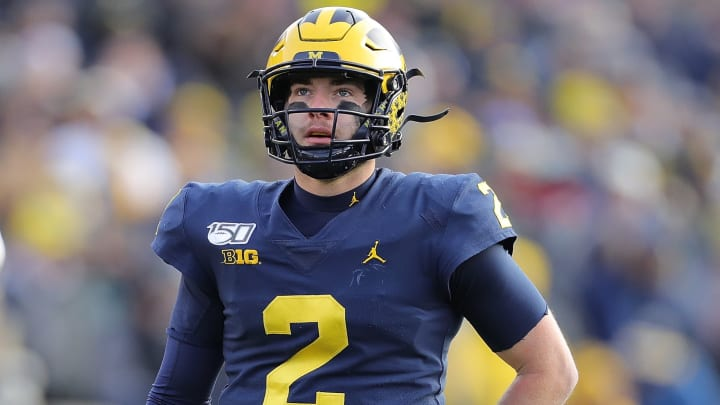 ANN ARBOR, MI - NOVEMBER 16: Shea Patterson #2 of the Michigan Wolverines watches the video replay during the fourth quarter of the game against the Michigan State Spartans at Michigan Stadium on November 16, 2019 in Ann Arbor, Michigan. Michigan defeated Michigan State 40-10. (Photo by Leon Halip/Getty Images)