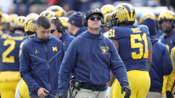 ANN ARBOR, MI - NOVEMBER 16: Michigan Wolverines Head Football Coach Jim Harbaugh watches the replay during the fourth quarter of the game against the Michigan State Spartans at Michigan Stadium on November 16, 2019 in Ann Arbor, Michigan. Michigan defeated Michigan State 40-10. (Photo by Leon Halip/Getty Images)