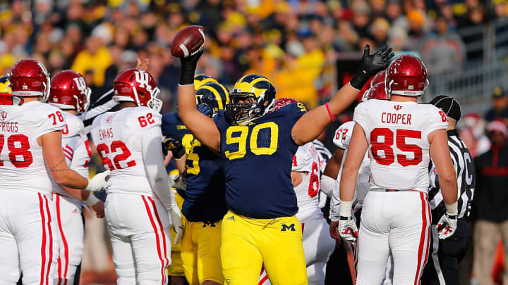 ANN ARBOR, MI - NOVEMBER 1: Bryan Mone #90 of the Michigan Wolverines celebrates after recovering the fumble during the first quarter of the game against Indiana Hoosiers at Michigan Stadium on November 1 , 2014 in Ann Arbor, Michigan. (Photo by Leon Halip/Getty Images)