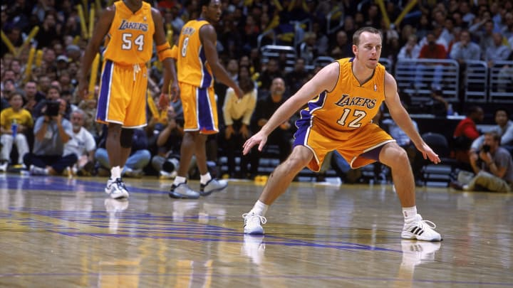 3 Jan 2001:  Mike Penberthy #12 of the Los Angeles Lakers is ready on the court during the game against the Utah Jazz at the STAPLES Center in Los Angeles, California.  The Lakers defeated the Jazz 82-71.  NOTE TO USER: It is expressly understood that the only rights Allsport are offering to license in this Photograph are one-time, non-exclusive editorial rights. No advertising or commercial uses of any kind may be made of Allsport photos. User acknowledges that it is aware that Allsport is an editorial sports agency and that NO RELEASES OF ANY TYPE ARE OBTAINED from the subjects contained in the photographs.Mandatory Credit: Robert Laberge  /Allsport