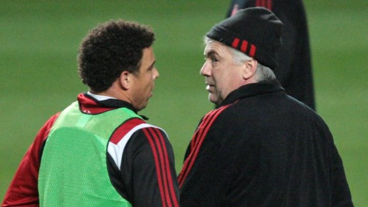 Milan's coach Carlo Ancelotti (R) chats