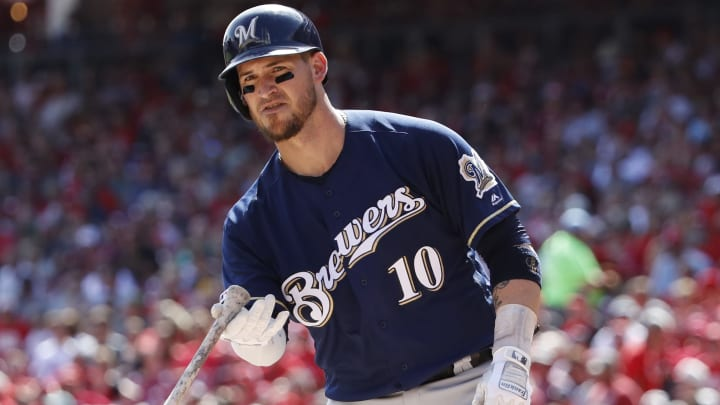 CINCINNATI, OH - SEPTEMBER 26: Yasmani Grandal #10 of the Milwaukee Brewers tosses his bat after drawing a walk during a game against the Cincinnati Reds at Great American Ball Park on September 26, 2019 in Cincinnati, Ohio. The Brewers defeated the Reds 5-3. (Photo by Joe Robbins/Getty Images)