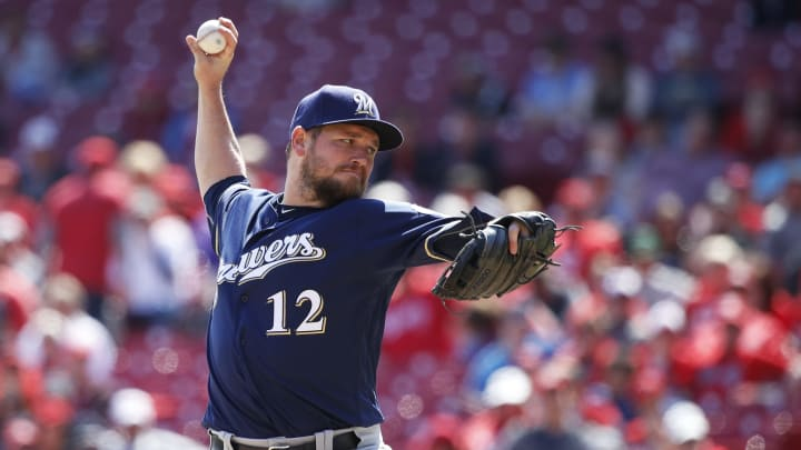 CINCINNATI, OH - APRIL 03: Alex Wilson #12 of the Milwaukee Brewers pitches in the ninth inning against the Cincinnati Reds at Great American Ball Park on April 3, 2019 in Cincinnati, Ohio. The Brewers won 1-0 to complete a three-game sweep. (Photo by Joe Robbins/Getty Images)