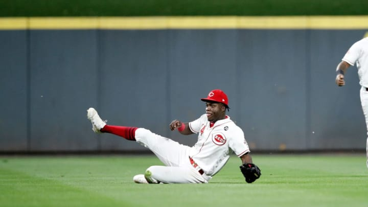 CINCINNATI, OH - SEPTEMBER 25: Aristides Aquino #44 of the Cincinnati Reds tries to make a sliding catch in the outfield during a game against the Milwaukee Brewers at Great American Ball Park on September 25, 2019 in Cincinnati, Ohio. The Brewers defeated the Reds 9-2. (Photo by Joe Robbins/Getty Images)