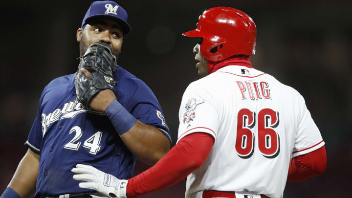 CINCINNATI, OH - APRIL 02: Yasiel Puig #66 of the Cincinnati Reds jokes with Jesus Aguilar #24 of the Milwaukee Brewers in the sixth inning at Great American Ball Park on April 2, 2019 in Cincinnati, Ohio. The Brewers won 4-3. (Photo by Joe Robbins/Getty Images)