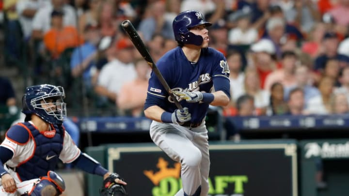 HOUSTON, TX - JUNE 11:  Christian Yelich #22 of the Milwaukee Brewers hits a home run in the third inning against the Houston Astros at Minute Maid Park on June 11, 2019 in Houston, Texas.  (Photo by Tim Warner/Getty Images)