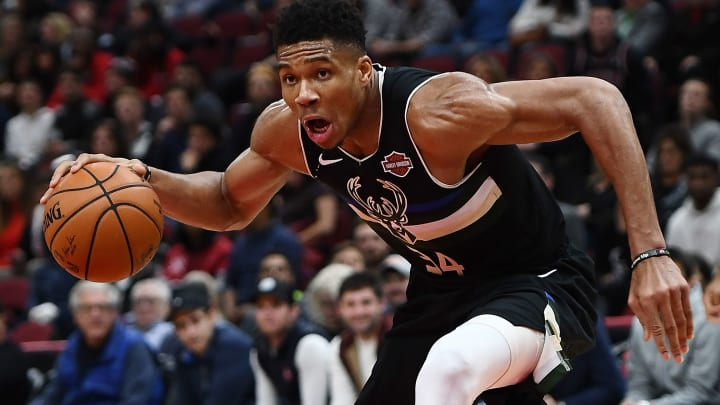CHICAGO, ILLINOIS - NOVEMBER 18:  Giannis Antetokounmpo #34 of the Milwaukee Bucks handles the ball during a game against the Chicago Bulls at United Center on November 18, 2019 in Chicago, Illinois. NOTE TO USER: User expressly acknowledges and agrees that, by downloading and or using this photograph, User is consenting to the terms and conditions of the Getty Images License Agreement. (Photo by Stacy Revere/Getty Images)