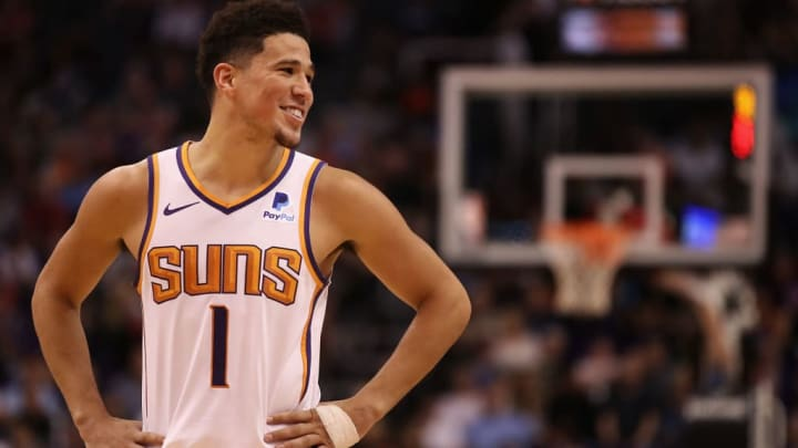 PHOENIX, ARIZONA - MARCH 04:  Devin Booker #1 of the Phoenix Suns reacts during the second half of the NBA game against the Milwaukee Bucks at Talking Stick Resort Arena on March 04, 2019 in Phoenix, Arizona. The Suns defeated the Bucks 114-105.  (Photo by Christian Petersen/Getty Images)