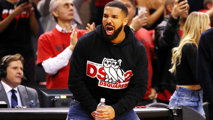 TORONTO, ONTARIO - MAY 21: Rapper Drake reacts during game four of the NBA Eastern Conference Finals between the Milwaukee Bucks and the Toronto Raptors at Scotiabank Arena on May 21, 2019 in Toronto, Canada. NOTE TO USER: User expressly acknowledges and agrees that, by downloading and or using this photograph, User is consenting to the terms and conditions of the Getty Images License Agreement. (Photo by Gregory Shamus/Getty Images)