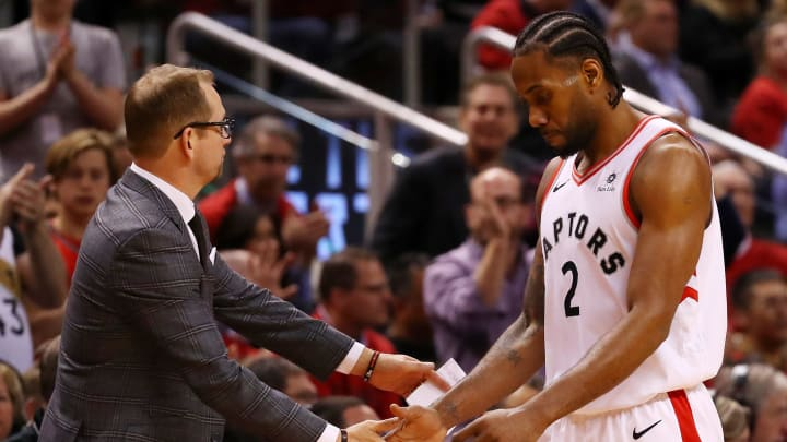 TORONTO, ONTARIO - MAY 21: Kawhi Leonard #2 of the Toronto Raptors high fives head coach Nick Nurse of the Toronto Raptors in game four of the NBA Eastern Conference Finals against the Milwaukee Bucks at Scotiabank Arena on May 21, 2019 in Toronto, Canada. NOTE TO USER: User expressly acknowledges and agrees that, by downloading and or using this photograph, User is consenting to the terms and conditions of the Getty Images License Agreement. (Photo by Gregory Shamus/Getty Images)