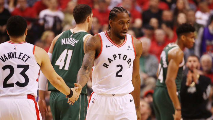 TORONTO, ONTARIO - MAY 21: Kawhi Leonard #2 of the Toronto Raptors high fives Fred VanVleet #23 during the first half in game four of the NBA Eastern Conference Finals against the Milwaukee Bucks at Scotiabank Arena on May 21, 2019 in Toronto, Canada. NOTE TO USER: User expressly acknowledges and agrees that, by downloading and or using this photograph, User is consenting to the terms and conditions of the Getty Images License Agreement. (Photo by Gregory Shamus/Getty Images)