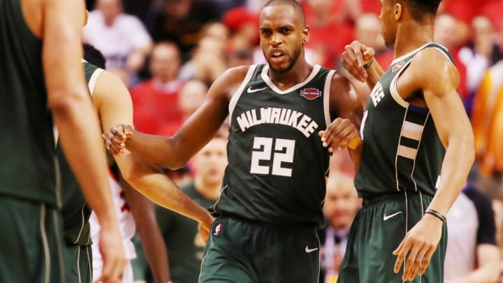 TORONTO, ONTARIO - MAY 19: Khris Middleton #22 of the Milwaukee Bucks celebrates with teammates after scoring a basket to tie the game during the fourth quarter against the Toronto Raptors in game three of the NBA Eastern Conference Finals at Scotiabank Arena on May 19, 2019 in Toronto, Canada. NOTE TO USER: User expressly acknowledges and agrees that, by downloading and or using this photograph, User is consenting to the terms and conditions of the Getty Images License Agreement. (Photo by Gregory Shamus/Getty Images)