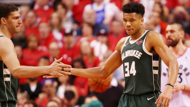 TORONTO, ONTARIO - MAY 19: Giannis Antetokounmpo #34 of the Milwaukee Bucks high fives Brook Lopez #11 during the second half in game three of the NBA Eastern Conference Finals against the Toronto Raptors at Scotiabank Arena on May 19, 2019 in Toronto, Canada. NOTE TO USER: User expressly acknowledges and agrees that, by downloading and or using this photograph, User is consenting to the terms and conditions of the Getty Images License Agreement. (Photo by Gregory Shamus/Getty Images)
