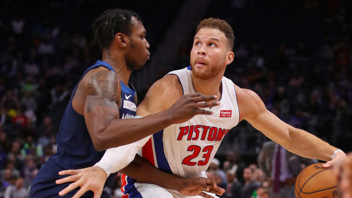 DETROIT, MICHIGAN - NOVEMBER 11: Blake Griffin #23 of the Detroit Pistons tries to get around the defense of Treveon Graham #12 of the Minnesota Timberwolves at Little Caesars Arena on November 11, 2019 in Detroit, Michigan. Minnesota won the game 120-114. NOTE TO USER: User expressly acknowledges and agrees that, by downloading and or using this photograph, User is consenting to the terms and conditions of the Getty Images License Agreement. (Photo by Gregory Shamus/Getty Images)