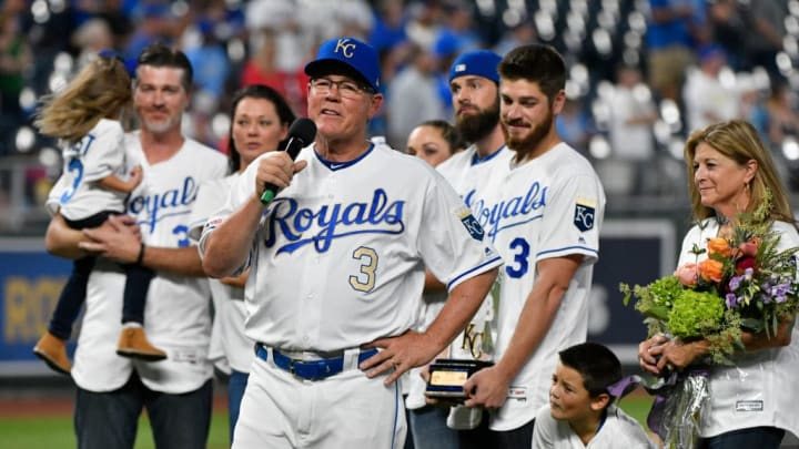 KANSAS CITY, MISSOURI - SEPTEMBER 27: Manager Ned Yost #3 of the Kansas City Royals address the crowd as his family looks on during a ceremony honoring his career in baseball prior to a game against the Minnesota Twins at Kauffman Stadium on September 27, 2019 in Kansas City, Missouri. Yost will retire as manager following the final game of the season. (Photo by Ed Zurga/Getty Images)