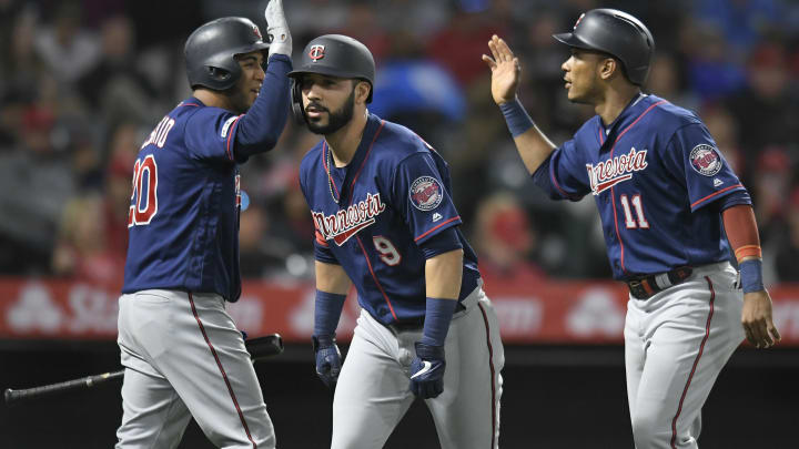 ANAHEIM, CA - MAY 21: Eddie Rosario #20 and Jorge Polanco #11 celebrate after Marwin Gonzalez #9 of the Minnesota Twins hit a two run home run against Justin Anderson #38 of the Los Angeles Angels of Anaheim on the sixth inning at Angel Stadium of Anaheim on May 21, 2019 in Anaheim, California. (Photo by John McCoy/Getty Images)