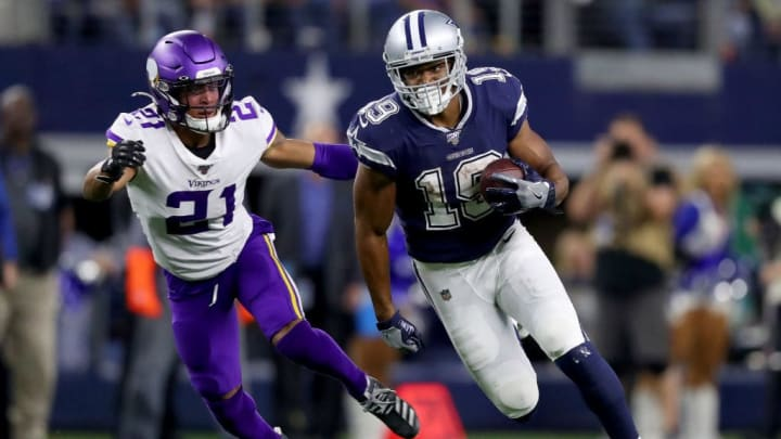 ARLINGTON, TEXAS - NOVEMBER 10: Amari Cooper #19 of the Dallas Cowboys carries the ball against Mike Hughes #21 of the Minnesota Vikings in the fourth quarter at AT&T Stadium on November 10, 2019 in Arlington, Texas. (Photo by Tom Pennington/Getty Images)