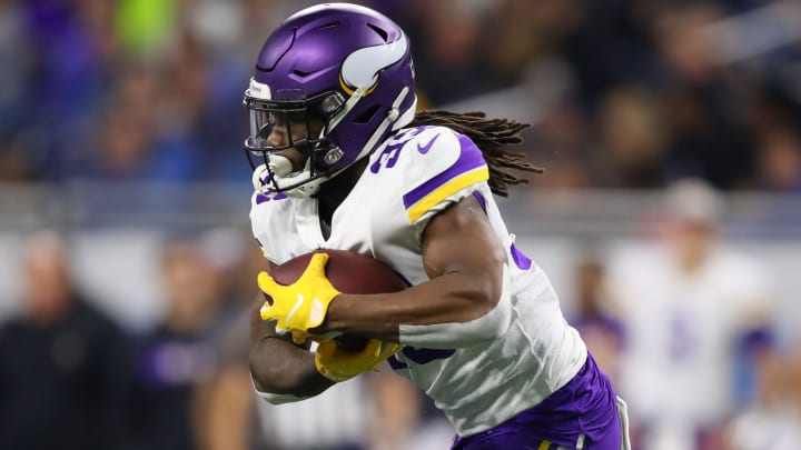 DETROIT, MI - DECEMBER 23: Dalvin Cook #33 of the Minnesota Vikings runs the ball in the first half against the Detroit Lions at Ford Field on December 23, 2018 in Detroit, Michigan. (Photo by Gregory Shamus/Getty Images)