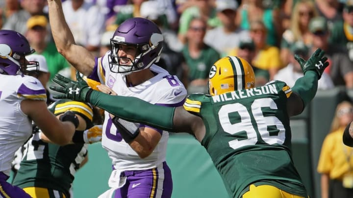 GREEN BAY, WI - SEPTEMBER 16:  Kirk Cousins #8 of the Minnesota Vikings passes under pressure from Muhammad Wilkerson #96 of the Green Bay Packers at Lambeau Field on September 16, 2018 in Green Bay, Wisconsin. The Vikings and the Packers tied 29-29 after overtime. (Photo by Jonathan Daniel/Getty Images)