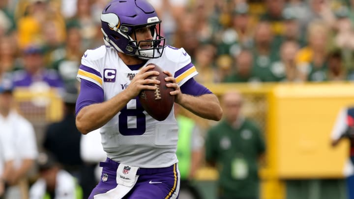 GREEN BAY, WISCONSIN - SEPTEMBER 15: Quarterback Kirk Cousins #8 of the Minnesota Vikings throws a pass against the Green Bay Packers in the game at Lambeau Field on September 15, 2019 in Green Bay, Wisconsin. (Photo by Dylan Buell/Getty Images)