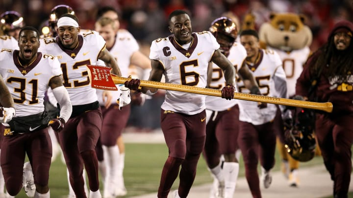 MADISON, WISCONSIN - NOVEMBER 24:  Tyler Johnson #6 of the Minnesota Golden Gophers celebrates with Paul Bunyan's Axe after beating the Wisconsin Badgers 37-15 at Camp Randall Stadium on November 24, 2018 in Madison, Wisconsin. (Photo by Dylan Buell/Getty Images)
