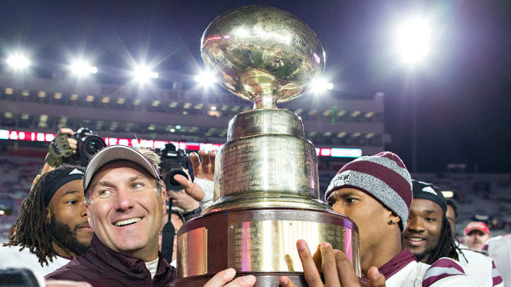 OXFORD, MS - NOVEMBER 26:  Head Coach Dan Mullen of the Mississippi State Bulldogs celebrates with his team after winning the Egg Bowl against the Mississippi Rebels at Vaught-Hemingway Stadium on November 26, 2016 in Oxford, Mississippi.  The Bulldogs defeated the Rebels 55-20.  (Photo by Wesley Hitt/Getty Images)