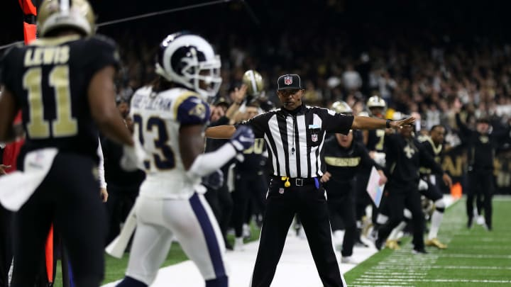 NEW ORLEANS, LOUISIANA - JANUARY 20:  A referee watches as Tommylee Lewis #11 of the New Orleans Saints drops a pass broken up by Nickell Robey-Coleman #23 of the Los Angeles Rams during the fourth quarter in the NFC Championship game at the Mercedes-Benz Superdome on January 20, 2019 in New Orleans, Louisiana. at Mercedes-Benz Superdome on January 20, 2019 in New Orleans, Louisiana.
