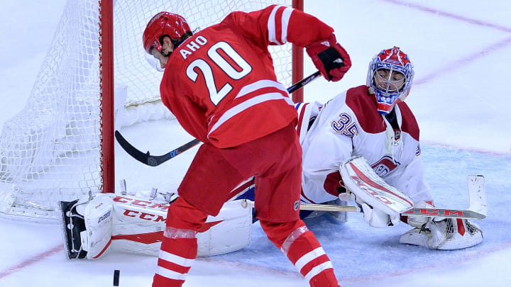 RALEIGH, NC - NOVEMBER 18:  Al Montoya #35 of the Montreal Canadiens blocks a shot by Sebastian Aho #20 of the Carolina Hurricanes during the game at PNC Arena on November 18, 2016 in Raleigh, North Carolina. The Hurricanes won 3-2.  (Photo by Grant Halverson/Getty Images)