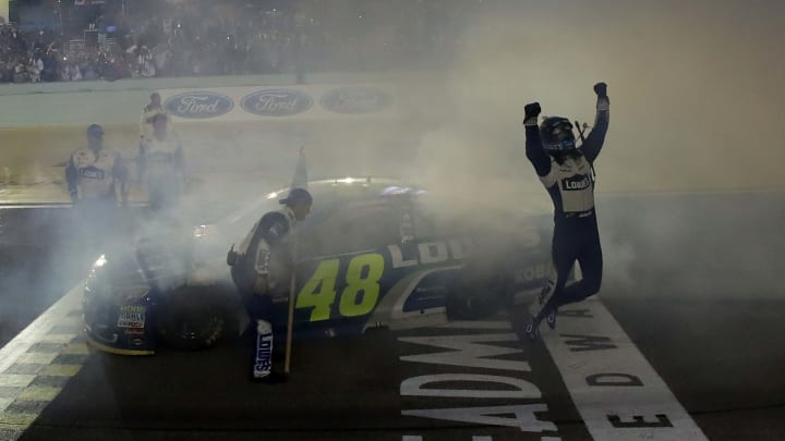 HOMESTEAD, FL - NOVEMBER 20:  Jimmie Johnson, driver of the #48 Lowe's Chevrolet, celebrates after winning the NASCAR Sprint Cup Series Ford EcoBoost 400 and the 2016 NASCAR Sprint Cup Series Championship at Homestead-Miami Speedway on November 20, 2016 in Homestead, Florida. Johnson wins a record-tying 7th NASCAR title.  (Photo by Sarah Crabill/Getty Images)
