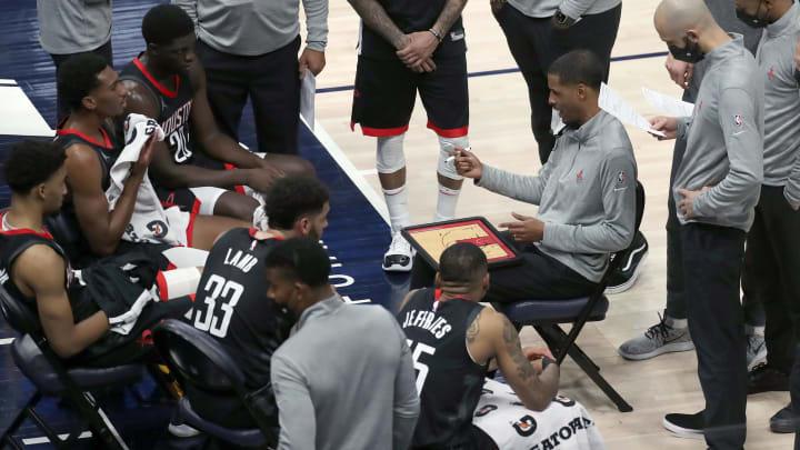 May 8, 2021; Salt Lake City, Utah, USA; Houston Rockets head coach Stephen Silas (right) draws up a