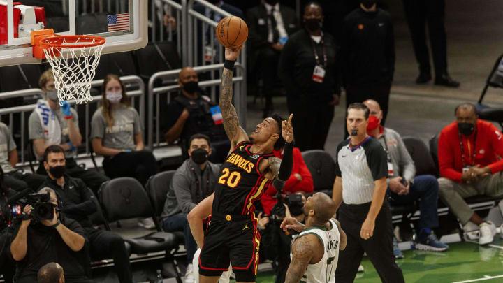 Jul 1, 2021; Milwaukee, Wisconsin, USA;  Atlanta Hawks forward John Collins (20) shoots in front of