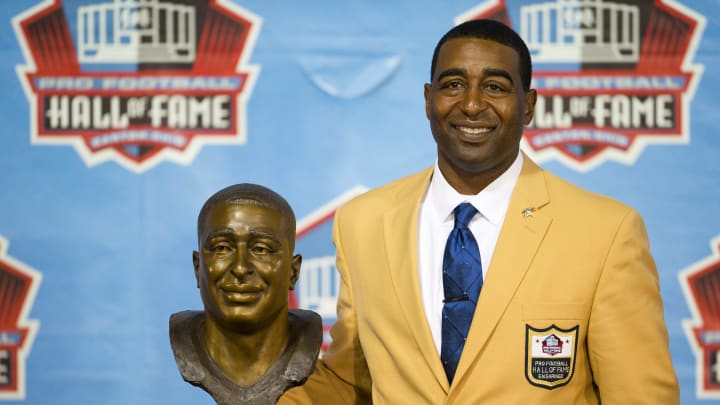 CANTON, OH - AUGUST 3: Former receiver Cris Carter of the Minnesota Vikings poses with his bust during the NFL Class of 2013 Enshrinement Ceremony at Fawcett Stadium on Aug. 3, 2013 in Canton, Ohio. (Photo by Jason Miller/Getty Images)