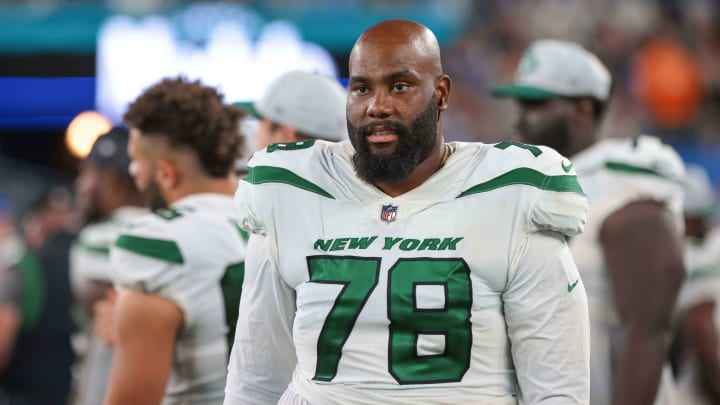 Aug 14, 2021; East Rutherford, New Jersey, USA; New York Jets offensive tackle Morgan Moses (78)