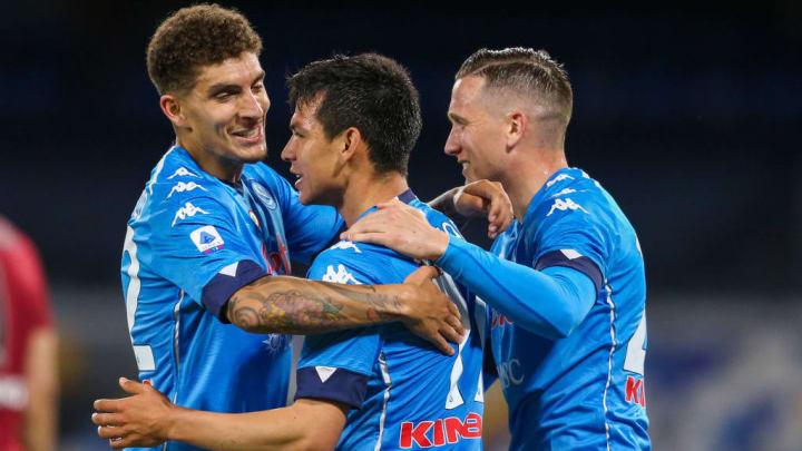 Napoli's Mexican forward Hirving Lozano celebrates with...