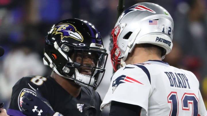 BALTIMORE, MARYLAND - NOVEMBER 03: Quarterback Tom Brady #12 of the New England Patriots (R) and quarterback Lamar Jackson #8 of the Baltimore Ravens talk before playing in an NFL game at M&T Bank Stadium on November 3, 2019 in Baltimore, Maryland. (Photo by Todd Olszewski/Getty Images)