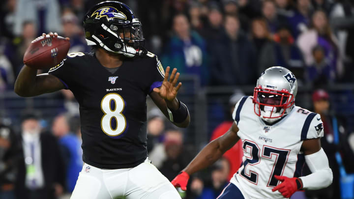 BALTIMORE, MARYLAND - NOVEMBER 03: Quarterback Lamar Jackson #8 of the Baltimore Ravens looks to pass in front of cornerback J.C. Jackson #27 of the New England Patriots during the first quarter at M&T Bank Stadium on November 3, 2019 in Baltimore, Maryland. (Photo by Will Newton/Getty Images)