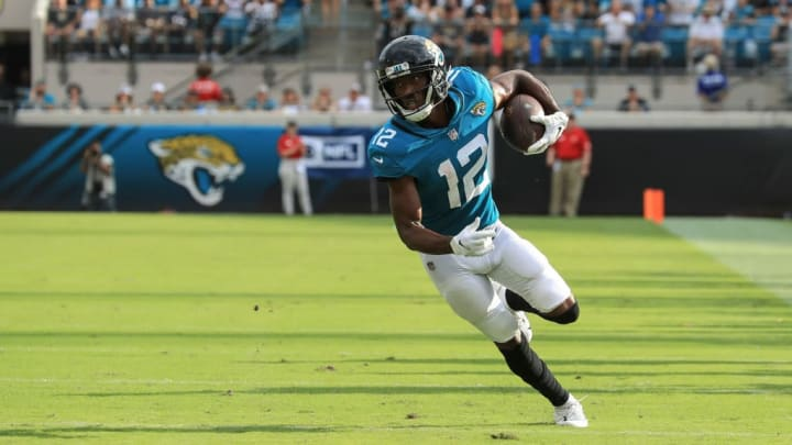 JACKSONVILLE, FL - SEPTEMBER 16: Dede Westbrook #12 of the Jacksonville Jaguars runs with the ball during the first half against the New England Patriots at TIAA Bank Field on September 16, 2018 in Jacksonville, Florida.  (Photo by Sam Greenwood/Getty Images)