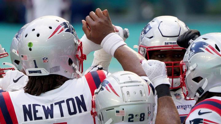 Cam Newton and his teammates.