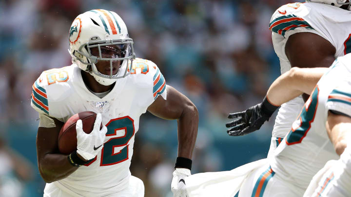 MIAMI, FLORIDA - SEPTEMBER 15: Kenyan Drake #32 of the Miami Dolphins runs with the ball against the New England Patriots during the second quarter in the game at Hard Rock Stadium on September 15, 2019 in Miami, Florida. (Photo by Michael Reaves/Getty Images)