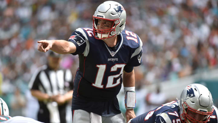 MIAMI, FL - SEPTEMBER 15: Tom Brady #12 of the New England Patriots points to the defense during the third quarter of the game against the Miami Dolphins at Hard Rock Stadium on September 15, 2019 in Miami, Florida. (Photo by Eric Espada/Getty Images)