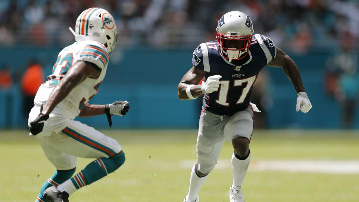 MIAMI, FLORIDA - SEPTEMBER 15: Antonio Brown #17 of the New England Patriots runs for the ball against Jomal Wiltz #33 of the Miami Dolphins during the second quarter in the game at Hard Rock Stadium on September 15, 2019 in Miami, Florida. (Photo by Michael Reaves/Getty Images)