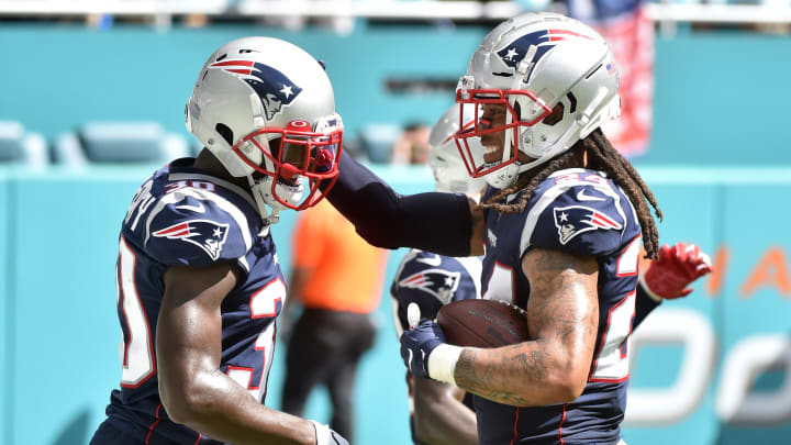 MIAMI, FL - SEPTEMBER 15: Stephon Gilmore #24 of the New England Patriots is congratulated by Jason McCourty #30 after returning a touchdown in the fourth quarter against the Miami Dolphins at Hard Rock Stadium on September 15, 2019 in Miami, Florida. (Photo by Eric Espada/Getty Images)