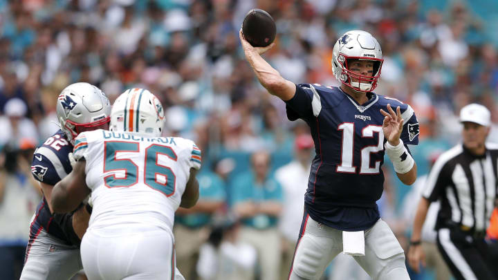 MIAMI, FLORIDA - SEPTEMBER 15: Tom Brady #12 of the New England Patriots throws a pass against the Miami Dolphins during the first half in the game at Hard Rock Stadium on September 15, 2019 in Miami, Florida. (Photo by Michael Reaves/Getty Images)