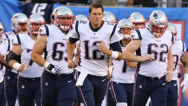 EAST RUTHERFORD, NJ - AUGUST 30: Tom Brady #12 of the New England Patriots leads his team out to the field in action against the New York Giants during a pre-season NFL game at MetLife Stadium on August 30, 2018 in East Rutherford, New Jersey. (Photo by Al Pereira/Getty Images)