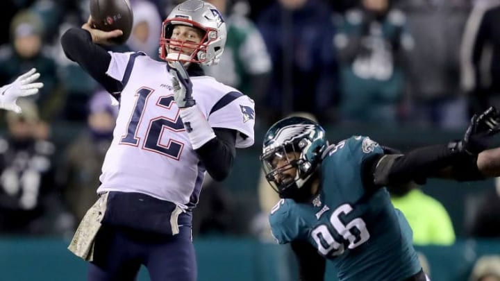 PHILADELPHIA, PENNSYLVANIA - NOVEMBER 17:  Tom Brady #12 of the New England Patriots passes as Derek Barnett #96 of the Philadelphia Eagles defends at Lincoln Financial Field on November 17, 2019 in Philadelphia, Pennsylvania.The New England Patriots defeated the Philadelphia Eagles 17-10. (Photo by Elsa/Getty Images)