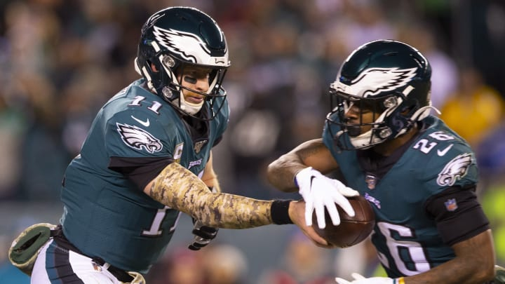 PHILADELPHIA, PA - NOVEMBER 17: Carson Wentz #11 of the Philadelphia Eagles hands the ball off to Miles Sanders #26 against the New England Patriots at Lincoln Financial Field on November 17, 2019 in Philadelphia, Pennsylvania. (Photo by Mitchell Leff/Getty Images)