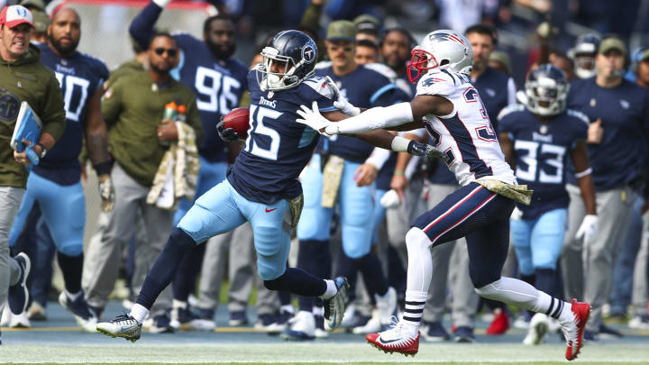 NASHVILLE, TN - NOVEMBER 11: Darius Jennings #15 of the Tennessee Titans runs downfield while defended by Devin McCourty #32 of the New England Patriots during the first quarter  at Nissan Stadium on November 11, 2018 in Nashville, Tennessee. (Photo by Silas Walker/Getty Images)