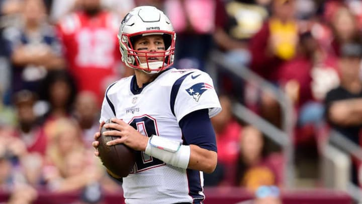 LANDOVER, MD - OCTOBER 06: Tom Brady #12 of the New England Patriots drops back to make a pass in the first half against the Washington Redskins at FedExField on October 6, 2019 in Landover, Maryland. (Photo by Patrick McDermott/Getty Images)
